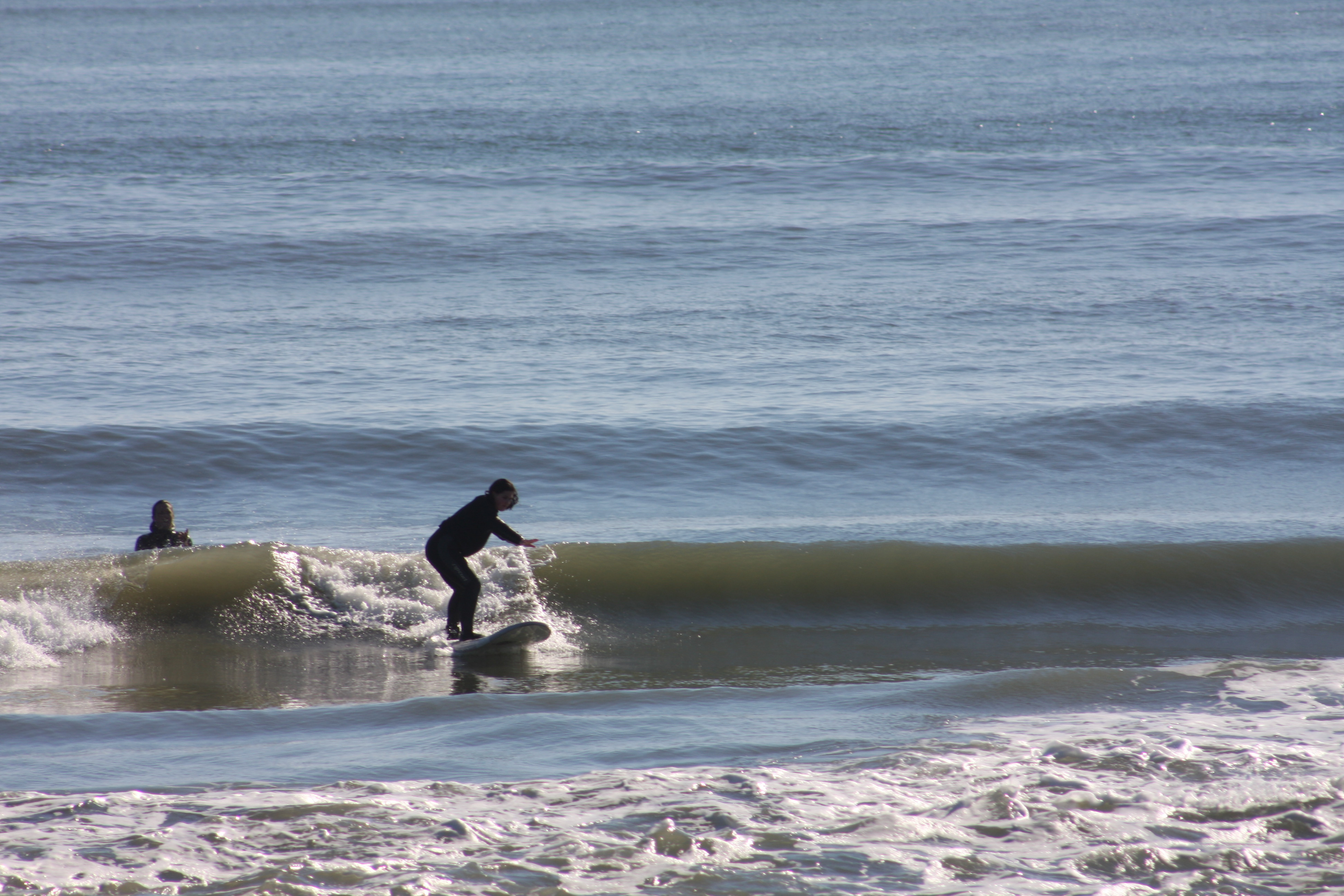 First time surfer getting some good waves during winter sessions