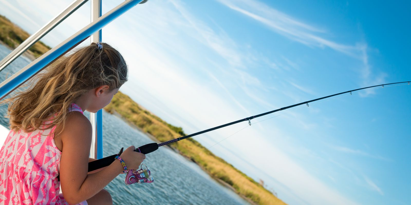 Girl fishing in Pamlico Sound on Hatteras Island