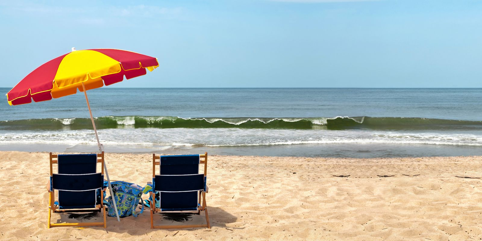 Beach chairs and umbrella on a Hatteras Island beach
