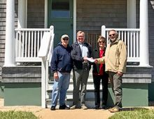 Midgett Realty's Tim Midgett and Susie Midgett Austin (center) present a check for $5,000 to Chicamacomico Historical Association President John Griffin (left) and Treasurer Ralph Buxton (right) to help support the Mirlo Centennial Commemoration Aug. 13-17, 2018. (CHA photo)