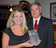 Beth Midgett accepts award for the 2015 REALTOR® of the Year