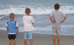 Kids enjoying time on the beach at Hatteras Island